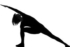 Utthita parsvakonasana女子瑜伽姿势 库存照片