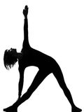Utthita trikonasana triangle pose position woman Royalty Free Stock Photos