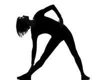 Utthita trikonasana triangle pose position woman. Posture position in silhouette on studio white background Royalty Free Stock Photos