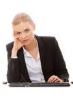 uttråkad affärskvinnaPCworking Arkivfoton