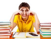 Uttråkad student med böcker arkivfoto