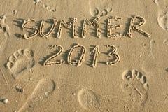 Uttrycka den skriftliga sommaren by i sanden Royaltyfri Foto