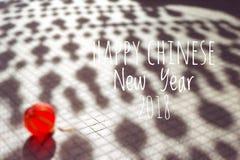 Uttrycka det lyckliga kinesiska nya året 2018 med kinesiska lyktor för suddig bakgrund under festival för nytt år Fotografering för Bildbyråer