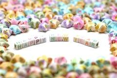 Uttrycka det lyckliga nya året med lyckliga stjärnor för origami Royaltyfri Fotografi