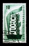Uttrycka EUROPA bak materialet till byggnadsställning för stålröret, den Europa flaggan, Europa C E P T serie circa 1956 Royaltyfri Bild