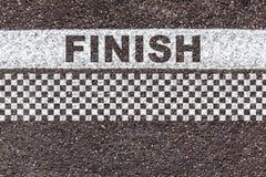 Uttrycka fullföljande i linje och kontrollerad modell på asfalttextur Royaltyfria Foton