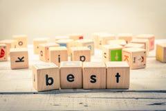 Uttrycka kubik för bästa ` för ` wood på trät royaltyfria bilder