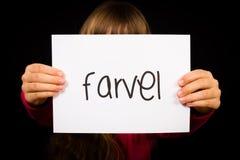 Uttrycker det hållande tecknet för barnet med danska Farvel - Bye Arkivbilder