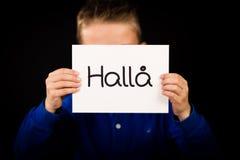Uttrycker det hållande tecknet för barnet med svensk Halla - Hello Arkivbild