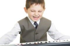 uttrycksfull liten pianist Arkivfoto