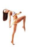 Uttrycksfull sportig kvinna med gult mått Royaltyfri Foto