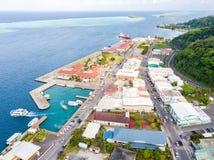 Uturoa, French Polynesia: City centre, port harbour, and ferries to Tahaa. Raiatea, Leeward/Society Islands, Oceania. Aerial view. stock photo
