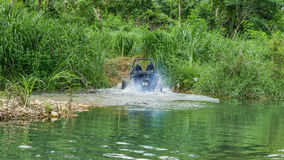 UTV off road four wheel drive. Sport car driving up the hill to the creek. Driving fun and safety Stock Image