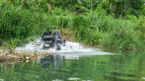 UTV off road four wheel drive. Sport car driving up the hill to the creek. Driving fun and safety Stock Photography