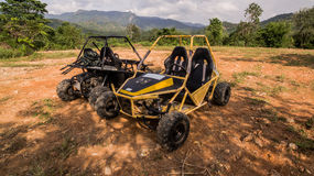 UTV off road four wheel drive. Sport car driving up the hill to the creek. Driving fun and safety Royalty Free Stock Photo