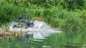 UTV off road four wheel drive. Sport car driving up the hill to the creek. Driving fun and safety Stock Images