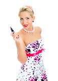 Utvikningsbildstående av kvinnan med läppstift. Arkivbilder