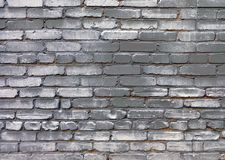 Uurban grunge background of old brick gray painted wall stock photography
