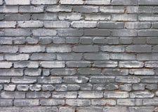 Uurban-Schmutzhintergrund der grauen gemalten Wand des alten Ziegelsteines stockfotografie