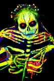 UV body art painting of helloween female skeleton. Día de los Muertos