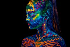 UV Body Art Painting Of Helloween Female African Warrior Stock Photos