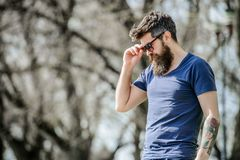 UV filter. Bearded hipster brutal man wear protective sunglasses. Man bearded with sunglasses nature background. Hipster stock photography