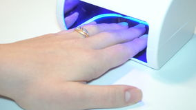 UV lamp for drying nails with gel method. stock video footage