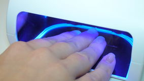 UV lamp for drying nails with gel method. stock footage