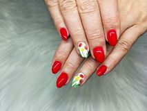Uv  painted nails  red royalty free stock image