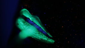 UV powder paint lips ultraviolet light. Lip color UV fluorescent powder in the light stock video
