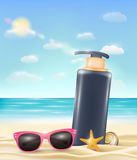 Uv protection cream tube with sun glasses starfish and shell on a sand beach Royalty Free Stock Image