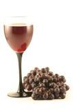 Uva e un vetro con vino fotografia stock libera da diritti