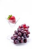 Uva roja con las fresas Foto de archivo libre de regalías