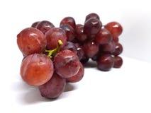 Uva rossa su priorità bassa bianca Immagini Stock Libere da Diritti