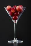 Uva rossa in un vetro Fotografie Stock