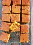 Uva sultanina e barre ghiacciate arancio fotografia stock