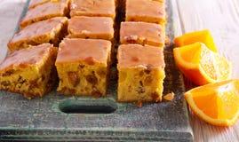 Uva sultanina e barre ghiacciate arancio fotografie stock
