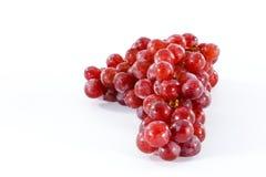Uva vermelha no fundo branco Imagens de Stock
