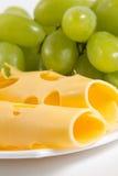 Uva y queso Imágenes de archivo libres de regalías