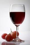 Uva y vino rojo Foto de archivo libre de regalías