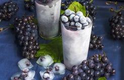Uvas congeladas com gelo Imagem de Stock