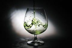 Uvas de vino en un vidrio Foto de archivo libre de regalías