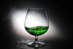 Uvas de vino en un vidrio Fotos de archivo libres de regalías