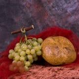 Uvas e pão Imagens de Stock