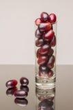 Uvas em um vidro Fotos de Stock