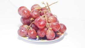 Uvas en la placa Imagen de archivo libre de regalías
