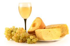 Uvas, queijo e um vidro. Fotos de Stock Royalty Free