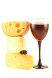 Uvas, queijo e um vidro Fotos de Stock Royalty Free