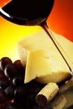 Uvas, queso y vino rojo Imagen de archivo libre de regalías