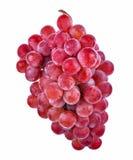 Uvas rojas aisladas en el fondo blanco Foto de archivo libre de regalías